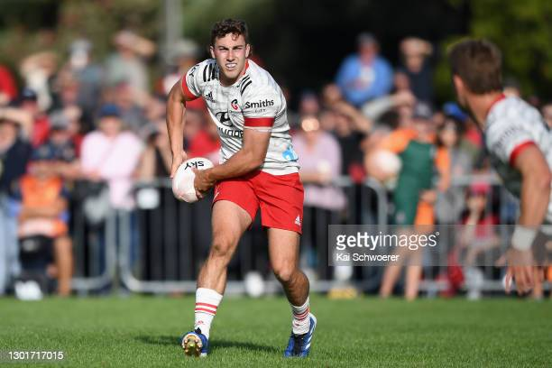 Josh McKay of the Crusaders looks to pass the ball during the Farmlands Cup pre-season Super Rugby Aotearoa match between the Crusaders and the...