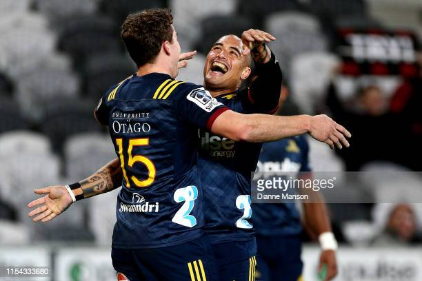 Josh McKay of the Highlanders celebrates his try with team-mate Aaron Smith during the round 17 Super Rugby match between the Highlanders and the...