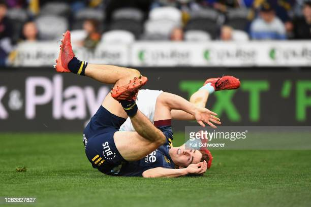 Josh McKay of the Highlanders reacts after Finlay Christie of the Blues scores a try during the round 8 Super Rugby Aotearoa match between the...