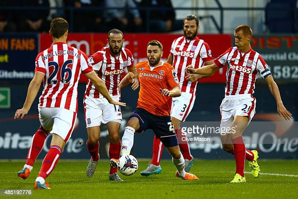 Josh McQuoid of Luton Town takes on the Stoke City defence Philipp Wollscheid Marc Wilson Erik Pieters and Steve Sidwell during the Capital One Cup...
