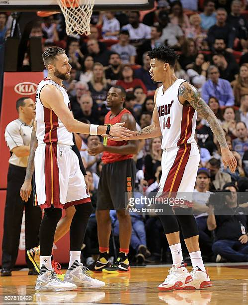 Josh McRoberts and Gerald Green of the Miami Heat high five during a game against the Atlanta Hawks at American Airlines Arena on January 31 2016 in...