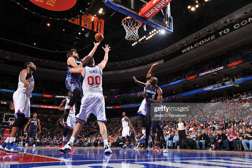 Josh McRoberts #11 of the Charlotte Bobcats drives to the basket against the Philadelphia 76ers on March 30, 2013 in Philadelphia, Pennsylvania.