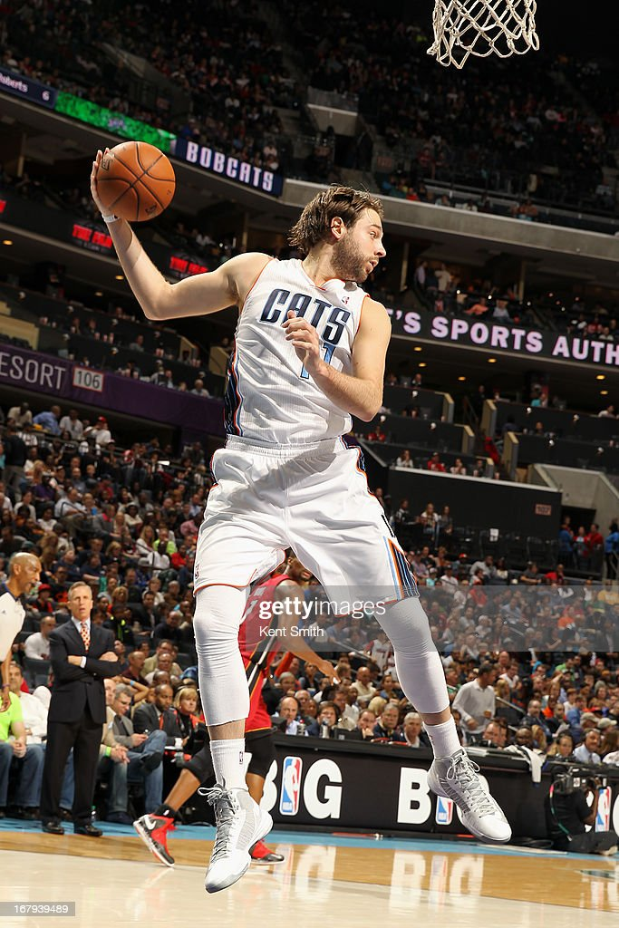 Josh McRoberts #11 of the Charlotte Bobcats grabs the rebound against the Miami Heat at the Time Warner Cable Arena on April 5, 2013 in Charlotte, North Carolina.