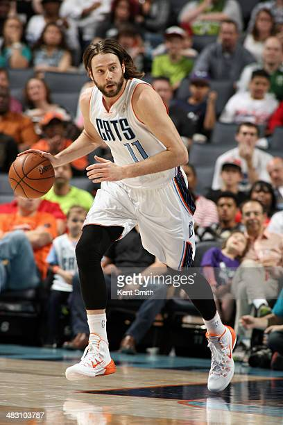 Josh McRoberts of the Charlotte Bobcats handles the ball against the Portland Trail Blazers during the game at the Time Warner Cable Arena on March...