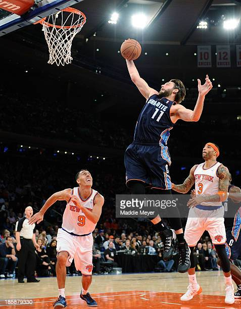 Josh McRoberts of the Charlotte Bobcats takes a shot against the New York Knicks during the first half of preseason play at Madison Square Garden on...