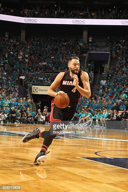 Josh McRoberts of the Miami Heat drives against the Charlotte Hornets in Game Six of the Eastern Conference Quarterfinals during the 2016 NBA...
