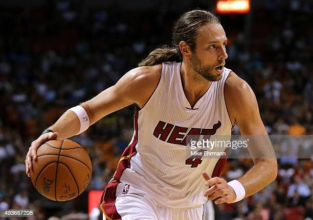 Josh McRoberts of the Miami Heat drives during a preseason game against the Washington Wizards at American Airlines Arena on October 21 2015 in Miami...