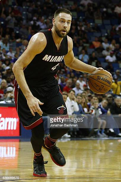 Josh McRoberts of the Miami Heat drives with the ball during the second half of a game against the New Orleans Pelicans at the Smoothie King Center...