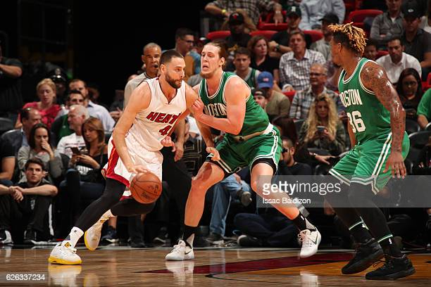 Josh McRoberts of the Miami Heat handles the ball during a game against the Boston Celtics on November 28 2016 at American Airlines Arena in Miami...