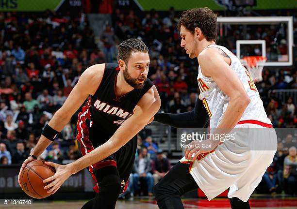 Josh McRoberts of the Miami Heat looks to drive against Mike Muscala of the Atlanta Hawks at Philips Arena on February 19 2016 in Atlanta Georgia...