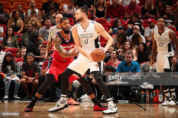 Josh McRoberts of the Miami Heat looks to pass the ball against Markieff Morris of the Washington Wizards during a game on December 12 2016 at...