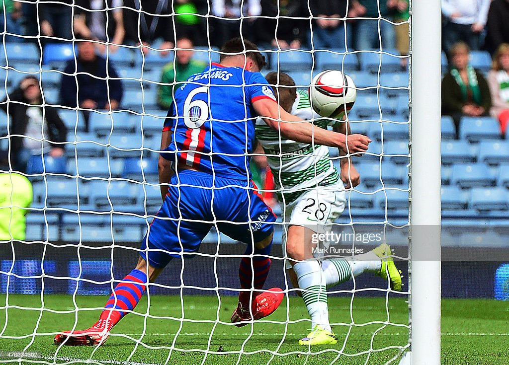 Josh Meekings of Caledonian Thistle apparently handles the ball on the goal line from Leigh Griffiths of Celtic during the William Hill Scottish Cup Semi Final match between Inverness Caledonian Thistle and Celtic at Hamden Park on April 19, 2015 in Glasgow Scotland.