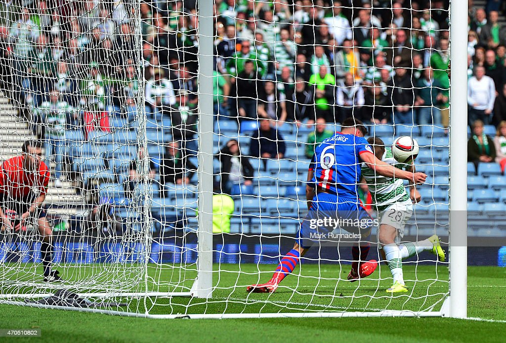 Josh Meekings of Inverness Caledonian Thistle apparently handles the ball on the goal line from Leigh Griffiths of Celtic in front of an assistant referee during the William Hill Scottish Cup Semi Final match between Inverness Caledonian Thistle and Celtic at Hamden Park on April 19, 2015 in Glasgow Scotland.