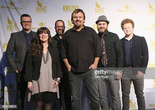Josh Mix Melodee Devevo Juan DeVevo Mark Hall Chris Huffman and Brian Scoggin of musical group Casting Crowns pose in the press room during the 2015...