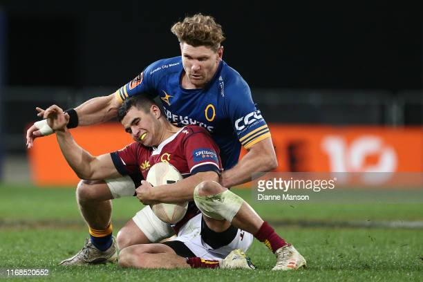 Josh Moorby of the Southland Stags is tackled by Adam Thomson of Otago during the round 2 Mitre 10 Cup match between Otago and Southland at Forsyth...