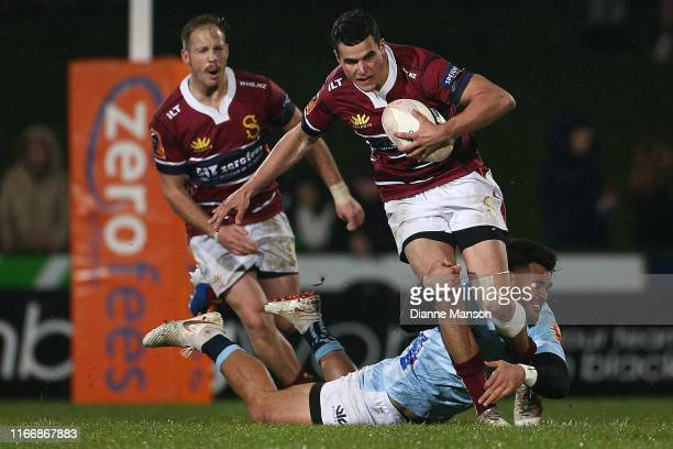 Josh Moorby of the Southland Stags is tackled by Matt Johnson of Northland during the round 1 Mitre 10 Cup match between Southland and Northland at...