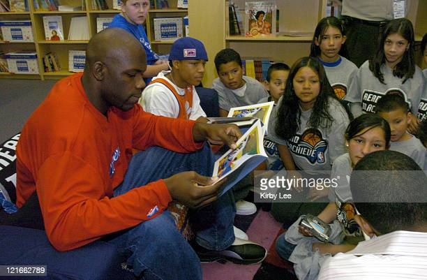 Josh Moore of the Los Angeles Clippers and Bow Wow read books to children at unveiling ceremony of reading and learning center at the Los Angeles...