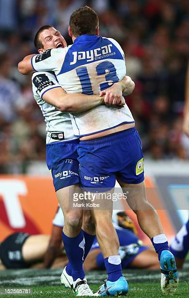 Josh Morris and Greg Eastwood of the Bulldogs celebrate a try during the NRL Preliminary Final match between the Canterbury Bulldogs and the South...