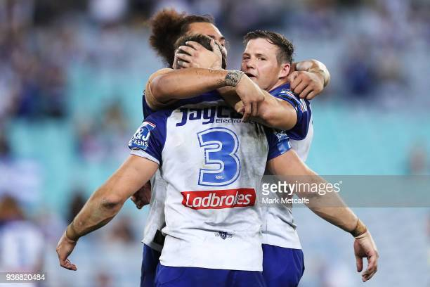 Josh Morris Brett Morris and Raymond FaitalaMariner of the Bulldogs celebrate victory in the round three NRL match between the Bulldogs and the...