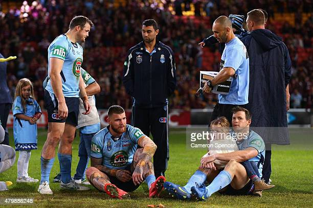 Josh Morris Josh Dugan and Brett Morris of the Blues look dejected after losing game three of the State of Origin series between the Queensland...