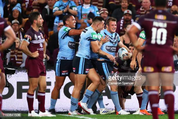 Josh Morris of the Blues celebrates with team mates after scoring a try during game one of the 2019 State of Origin series between the Queensland...