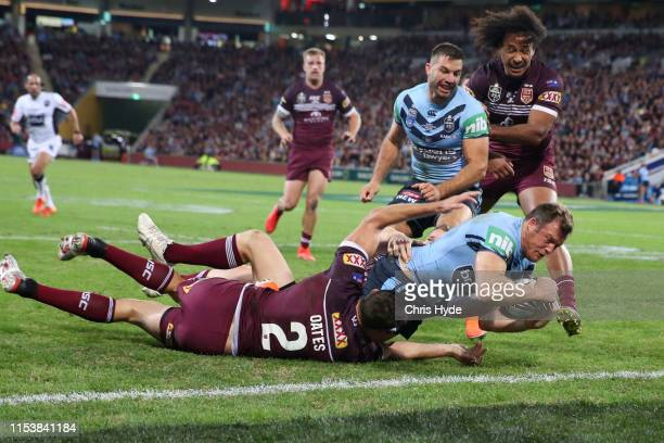 Josh Morris of the Blues scores a try during game one of the 2019 State of Origin series between the Queensland Maroons and the New South Wales Blues...