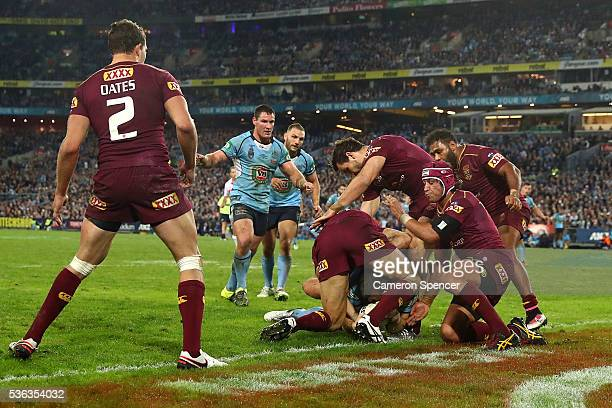 Josh Morris of the Blues scores a try which was later over turned by the bunker during game one of the State Of Origin series between the New South...