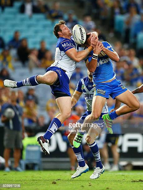 Josh Morris of the Bulldogs and Corey Norman of the Eels contest a high ball during the round nine NRL match between the Parramatta Eels and the...