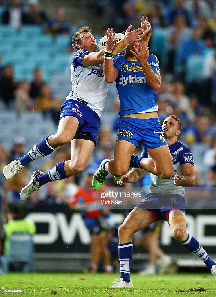 Josh Morris of the Bulldogs and Corey Norman of the Eels contest a high ball during the round nine NRL match between the Parramatta Eels and the Canterbury Bulldogs at ANZ Stadium on April 29, 2016 in Sydney, Australia.