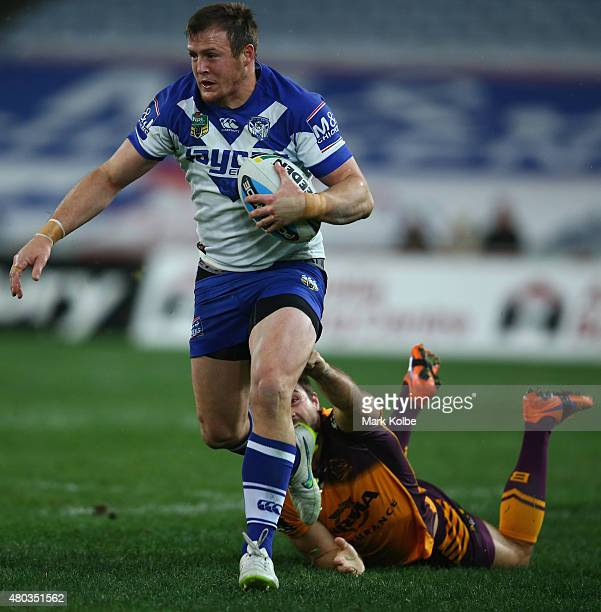Josh Morris of the Bulldogs beats the tackle of Ben Hunt of the Bulldogs during the round 18 NRL match between the Canterbury Bulldogs and the...