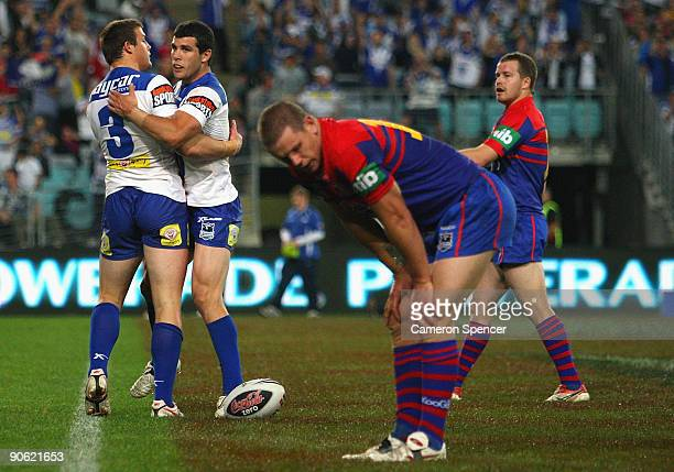 Josh Morris of the Bulldogs celebrates scoring a try with team mates Michael Ennis during the third NRL qualifying final match between the Bulldogs...