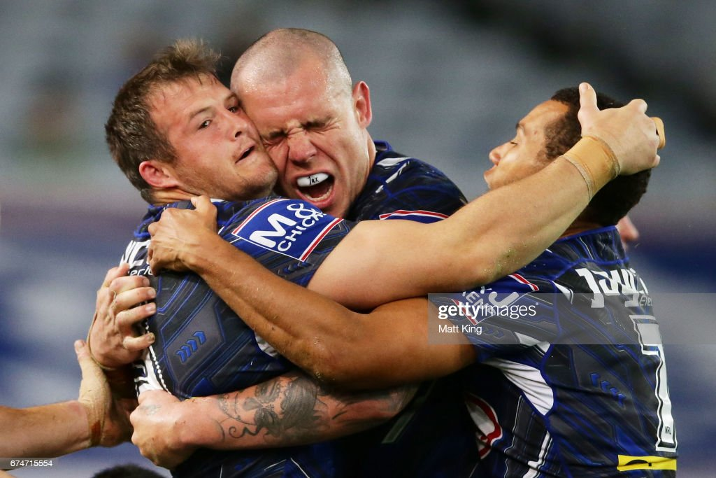 Josh Morris of the Bulldogs (L) celebrates with David Klemmer of the Bulldogs (C) after scoring a try during the round nine NRL match between the Canterbury Bulldogs and the Canberra Raiders at ANZ Stadium on April 29, 2017 in Sydney, Australia.