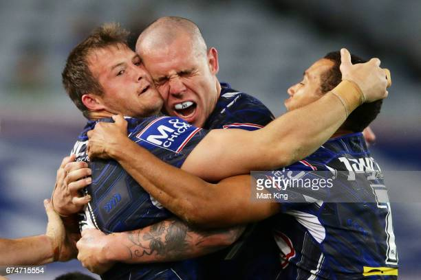Josh Morris of the Bulldogs celebrates with David Klemmer of the Bulldogs after scoring a try during the round nine NRL match between the Canterbury...