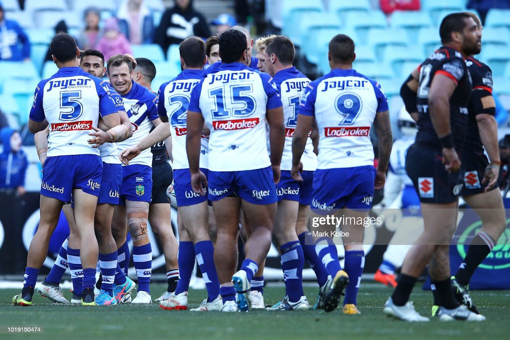 Josh Morris of the Bulldogs celebrates with his team mates after scoring a try during the round 23 NRL match between the Canterbury Bulldogs and the New Zealand Warriors at ANZ Stadium on August 19, 2018 in Sydney, Australia.