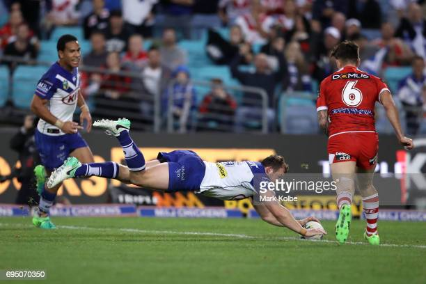 Josh Morris of the Bulldogs dives over to score a try during the round 14 NRL match between the Canterbury Bulldogs and the St George Illawarra...