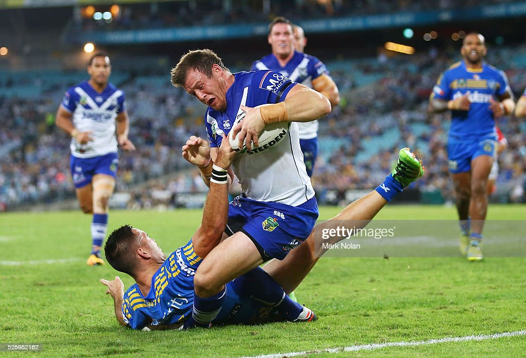 Josh Morris of the Bulldogs heads for the try line to score during the round nine NRL match between the Parramatta Eels and the Canterbury Bulldogs at ANZ Stadium on April 29, 2016 in Sydney, Australia.