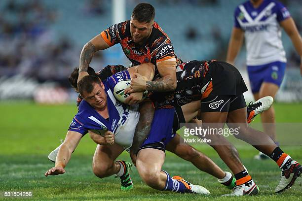 Josh Morris of the Bulldogs is tackled during the round 10 NRL match between the Wests Tigers and the Canterbury Bulldogs at ANZ Stadium on May 15...