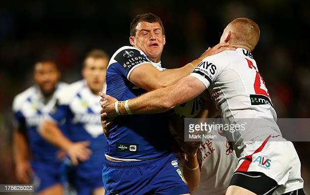 Josh Morris of the Bulldogs is tackled during the round 21 NRL match between the St George Dragons and the Canterbury Bulldogs at WIN Jubilee Stadium...