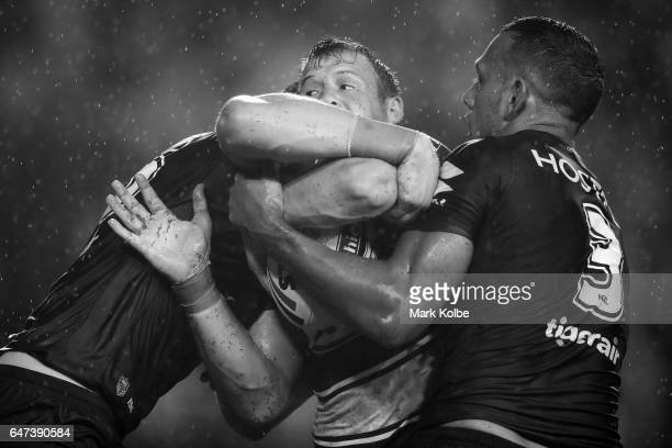 Josh Morris of the Bulldogs is tackled during the round one NRL match between the Canterbury Bulldogs and the Melbourne Storm at Belmore Sports...