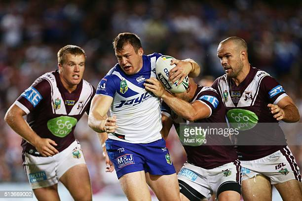 Josh Morris of the Bulldogs is tackled uring the round one NRL match between the Manly Warringah Sea Eagles and the Canterbury Bulldogs at Brookvale...