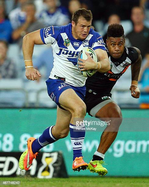 Josh Morris of the Bulldogs makes a break during the round four NRL match between the Wests Tigers and the Canterbury Bulldogs at ANZ Stadium on...