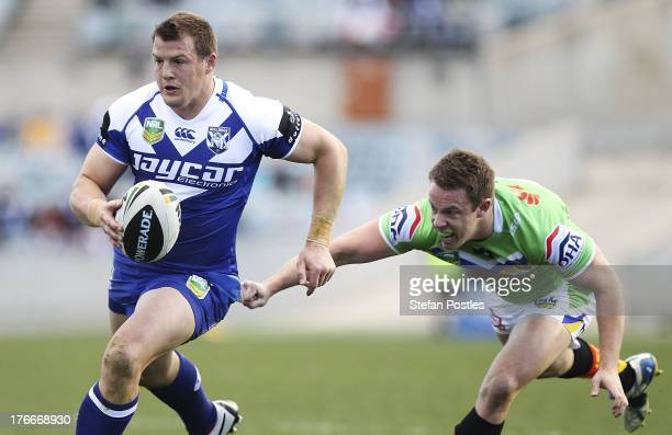 Josh Morris of the Bulldogs runs the ball during the round 23 NRL match between the Canberra Raiders and the Canterbury Bulldogs at Canberra Stadium...