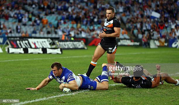 Josh Morris of the Bulldogs scores a try during the round four NRL match between the Wests Tigers and the Canterbury Bulldogs at ANZ Stadium on March...
