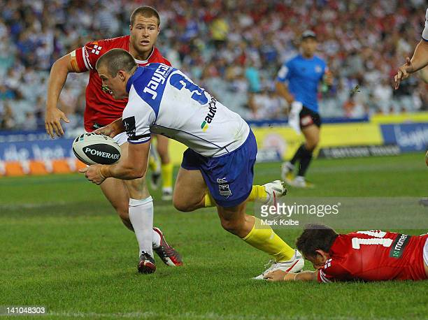 Josh Morris of the Bulldogs scores a try during the round two NRL match between the Canterbury Bulldogs and the St George Illawarra Dragons at ANZ...
