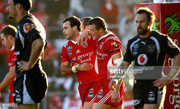 Josh Morris of the Dragons is congratulated by team mates after he scored during the round 24 NRL match between the St George-Illawarra Dragons and...