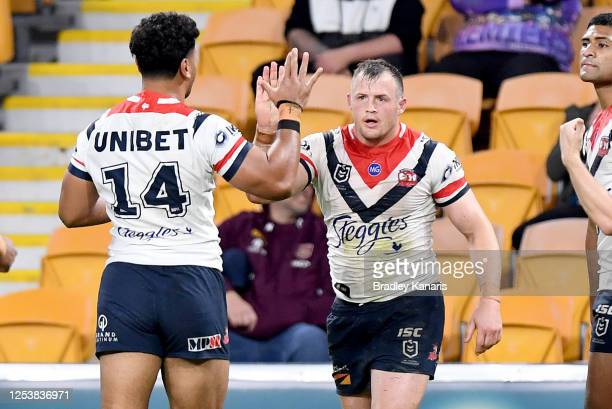 Josh Morris of the Roosters celebrates with team mates after scoring a try during the round eight NRL match between the Melbourne Storm and the...