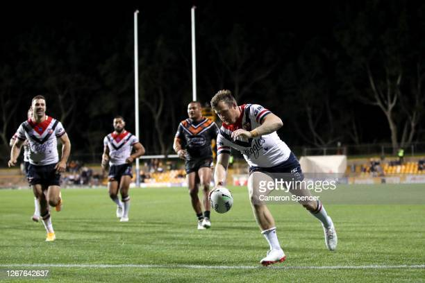Josh Morris of the Roosters dives over to score a try during the round 15 NRL match between the Wests Tigers and the Sydney Roosters at Leichhardt...