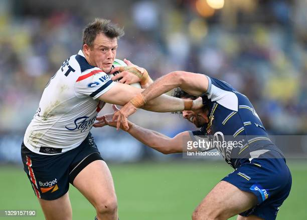 Josh Morris of the Roosters gets past Jake Granville of the Cowboys during the round 18 NRL match between the North Queensland Cowboys and the Sydney...