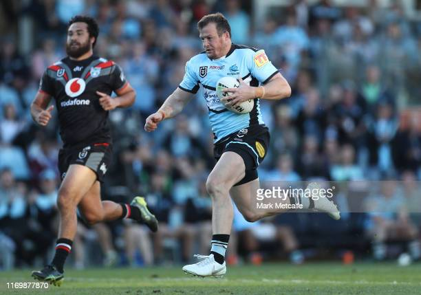 Josh Morris of the Sharks runs in for a try during the round 23 NRL match between the Cronulla Sharks and the New Zealand Warriors at Shark Park on...