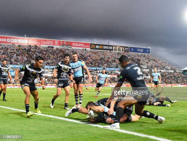 Josh Morris of the Sharks scores a try during the round three NRL match between the North Queensland Cowboys and the Cronulla Sharks at 1300SMILES...